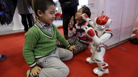 "A ""Nao"" humanoid robot by Aldebaran Robotics dances to the Chinese song ""Little Apple"" at the World Robot Exhibition during the World Robot Conference in Beijing, China, November 24, 2015. The conference, which kicked off in Beijing on Monday, is a three-day event including a forum, an exhibition and a robot contest for youth, Xinhua News Agency reported. REUTERS/Jason Lee - RTX1VJSC"