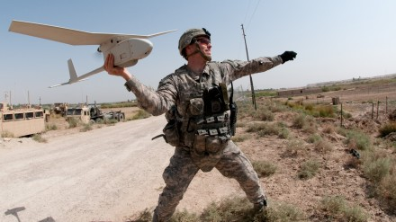 091009-A-3108M-009         U.S. Army 1st Lt. Steven Rose launches an RQ-11 Raven unmanned aerial vehicle near a new highway bridge project along the Euphrates River north of Al Taqqadum, Iraq, on Oct. 9, 2009.  Rose is assigned to Charlie Company, 1st Battalion, 504th Parachute Infantry Regiment, 1st Brigade Combat Team, 82nd Airborne Division which is assisting Iraqi police in providing security for the work site.  DoD photo by Spc. Michael J. MacLeod, U.S. Army.  (Released)