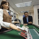 Jay Chun, chairman of Paradise Entertainment Ltd., stands for a photograph with Min, a prototype human-like electronic croupier, at the company's headquarters in Macau, China, on Tuesday, Dec. 1, 2015. Paradise, a Hong Kong-based gaming machine manufacturer and supplier, says the robot could cut labor costs and open up new markets for casino operators. Photographer: David Paul Morris/Bloomberg *** Local Caption *** Jay Chun