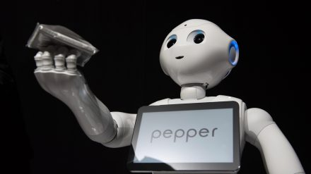 SoftBank Corp.'s Pepper humanoid robot stands during a news conference in Urayasu, Chiba Prefecture, Japan, on Thursday, June 18, 2015. SoftBank will start sales of its Pepper robot to consumers Saturday in a bid to spur adoption. Photographer: Akio Kon/Bloomberg