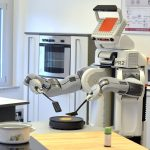 epa03603034 Robot 'PR2' flips a pancake in a laboratory kitchen of the Institute for Artificial Intelligence (IAI) at the Institute of Informatics and Automation (TZI) of Bremen University in Bremen, Germany, 27 February 2013. The robot can experimentally do household tasks and is part of a Europe wide project.  EPA/Michael Bahlo